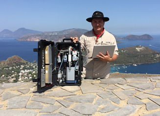 Professor Dr. Andres Diaz, of the University of Costa Rica with the mobile system on a volcano in Italy