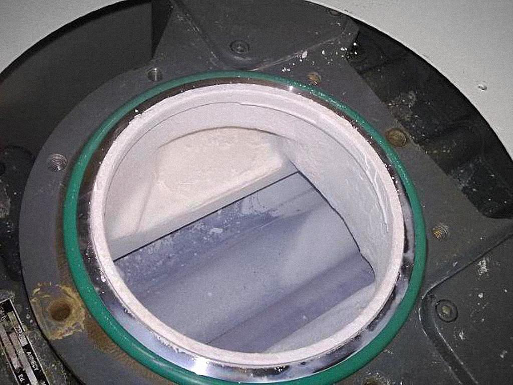 무척 낮은 온도에서 작동되는 루츠 펌프의 암모늄 헥사 플루오르 (NH<sub>4</sub>) 2SIF<sub>6</sub> 의 응축